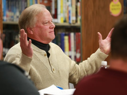 Corwith mayor Dave Wagner looks to a group of community members for further questions during a city council meeting where the future of the Corwith-Wesley-Lu Verne high school building following the dissolution of the district at the conclusion of the 2014-2015 school year, seen here on Tuesday, Nov. 18, 2014, in Corwith, Iowa.