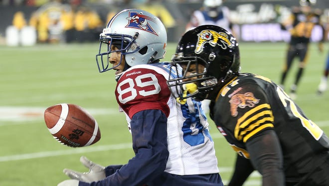 Duron Carter of the Montreal Alouettes drops a ball against the Hamilton Tiger-Cats in a CFL football game at Tim Hortons Field on November 8, 2014 in London, Ontario, Canada.