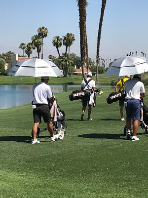 Each players takes on the heat of the desert in their own way at the AJGA event in the desert. Some use umbrellas, some chose not to during the week.