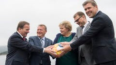 Nordic Prime Ministers, from left, Stefan Lofven of Sweden, Lars Lokke Rasmussen of Denmark, Erna Solberg of Norway, Juha Sipila of Finland and Bjarni Benediktsson of Iceland hold their hands on a soccer ball during a meeting in Bergen, Norway on Monday.