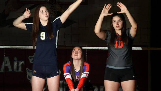 Prep Volleyball Players of the Year are, from left, Hitter Monica Roberts of Coronado, defensive player Chelcie Spence of Eastlake and setter Priscilla Sanchez of El Paso High.