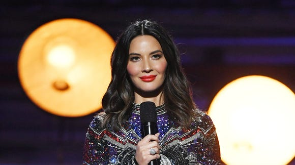 Host Olivia Munn takes the mike during the 23rd annual