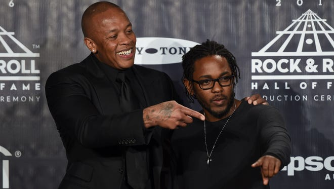 Kendrick Lamar, right, and his mentor, Dr. Dre.