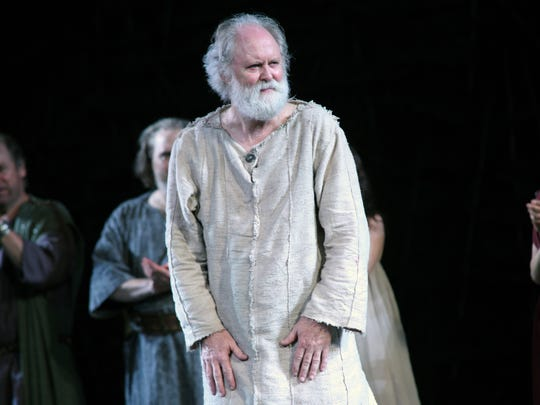 """Actor John Lithgow stands onstage during the opening night curtain call of """"King Lear"""" on Aug. 5 in New York."""