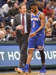 New York Knicks head coach Jeff Hornacek talks to guard
