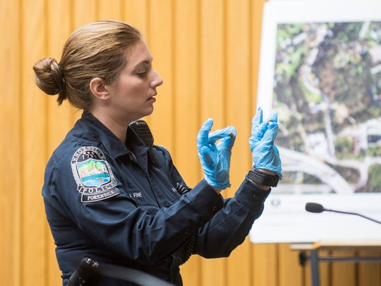 KPD evidence technician Bethany Fine shows the jury the difference between two types of bullets during the Zaevion Dobson slaying trial at Knox County Criminal Court on Wednesday, Dec. 6, 2017.