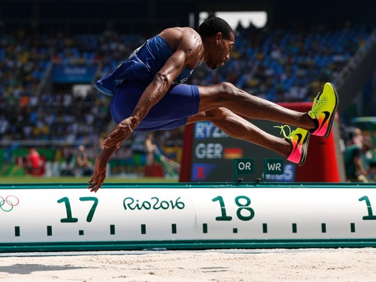 American Christian Taylor made it a double in the triple jump, defending his 2012 London Games title.
