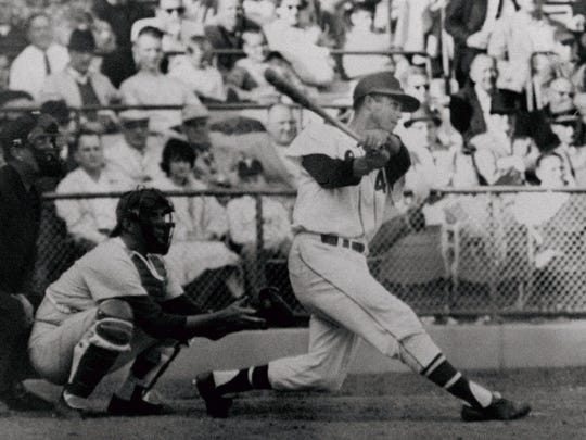 Milwaukee slugger Eddie Mathews connects for his 400th major league homer in the eighth inning against the Philadelphia Phillies, in this April 16, 1963 photo in Milwaukee
