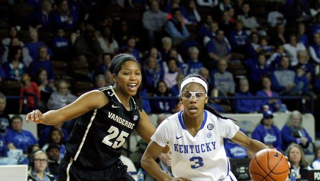 Mar 2, 2014; Lexington, KY, USA; Kentucky Wildcats guard Janee Thompson (3) dribbles the ball against Vanderbilt Commodores guard Morgan Batey (25) at Memorial Coliseum. Mandatory Credit: Mark Zerof-USA TODAY Sports