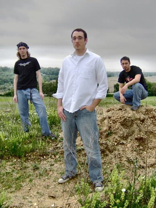 The members of Lookout Point aren t nearly as serious as they look in this picture. See that guy on the left? He listens to Eddie Money. From left to right: Dustin Ward, Andy Goforth and Pete Baker.