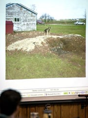 A photo of the burn pit with Steven Avery's dog, Bear, at the Avery salvage yard is projected on the screen in the courtroom on Feb. 28, 2007.
