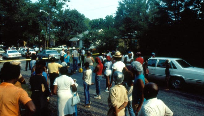Noel Memorial Library/LSUS Archives A crowd gathers on the Cedar Grove street where four bodies were found July 19, 1985. Nathaniel Code was tried for the homicides of Vivian Chaney, Carlitha Culbert, Jerry Culbert and Billy Joe Harris, and was given the death penalty in 1990. However, he remains on Louisiana's death row. A crowd gathers on the Cedar Grove street where four bodies were found July 19, 1985. Nathaniel Code was tried for the homicides of Vivian Chaney, Carlitha Culbert, Jerry Culbert and Billy Joe Harris, and was given the death penalty in 1990. However, he remains on Louisiana's death row.