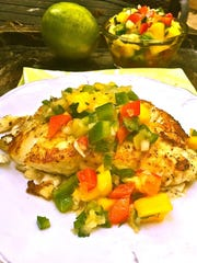 Mango salsa tops lightly grilled group for a perfect summer supper.