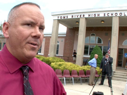 Daniel Leonard, a Toms River Regional School board member representing Beachwood, speaks about funding cuts after a news conference held outside Toms River High School South Wednesday afternoon, Jun 21, 2017.