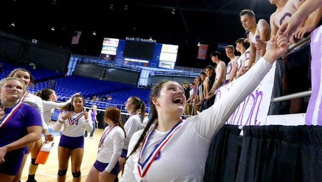 PortlandÕs McKenna Parker (3) celebrates the team's state championship win over Knoxville Catholic after the TSSAA Class AA State GirlsÕ State Championship Volleyball game with the student body, on Thursday, Oct. 19, 2017, at MTSU.