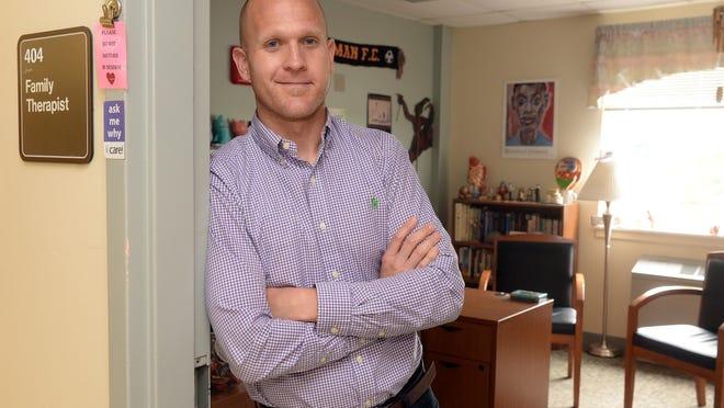 Behavioral health social worker Joe O'Brien of Pittman stands in his office, before taking time to meditate, at Inspira Health Center Bridgeton, Wednesday, Jun. 3, 2015 in Bridgeton.