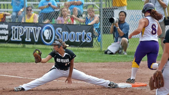 Mid-Prairie's ( Wellman ) first baseman #17 Emma Troyer stretched out for the throw and the out on East Marshall's #8 Haley Long in Class 3-A quarterfinal game at the 2014 Girls State Softball Tournament in Ft. Dodge on Monday July 21, 2014.