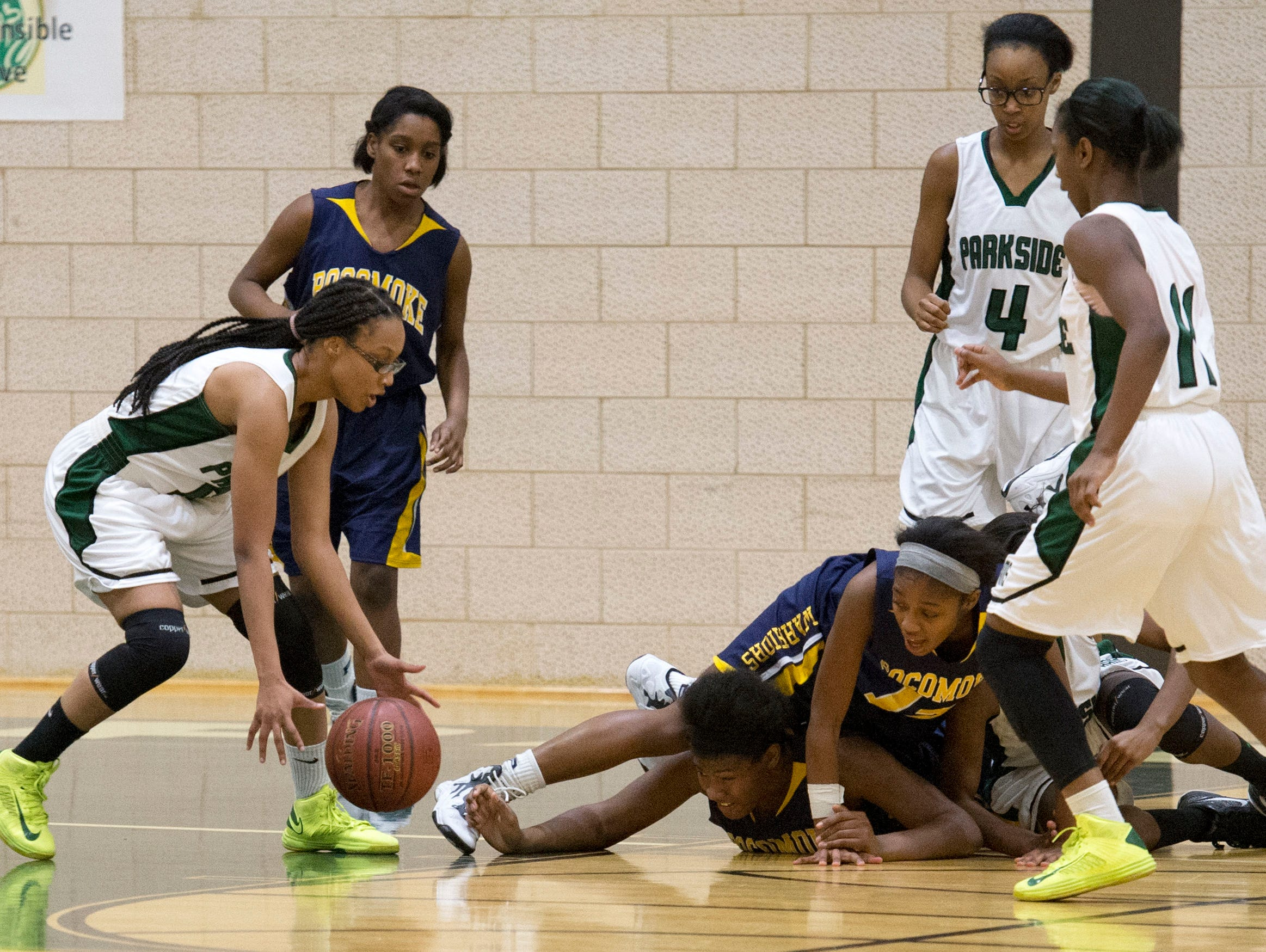 Parkside's Takeriah Jackson (5) grabs a loose ball during a game against Pocomoke at Parkside Tuesday.