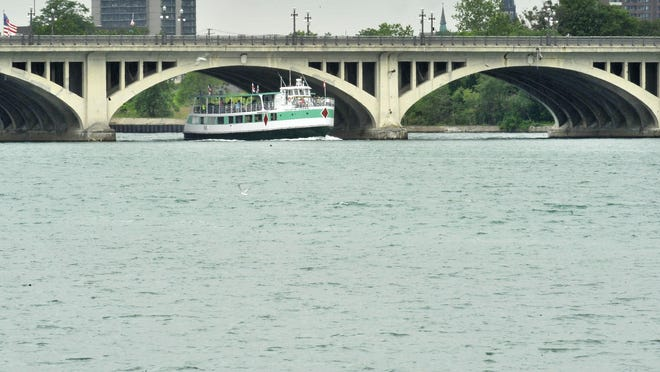 File: The Belle Isle bridge is seen over the Detroit River with Detroit skyline in background.