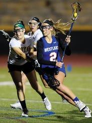 Westlake High sophomore Shelby Tilton, right dodges