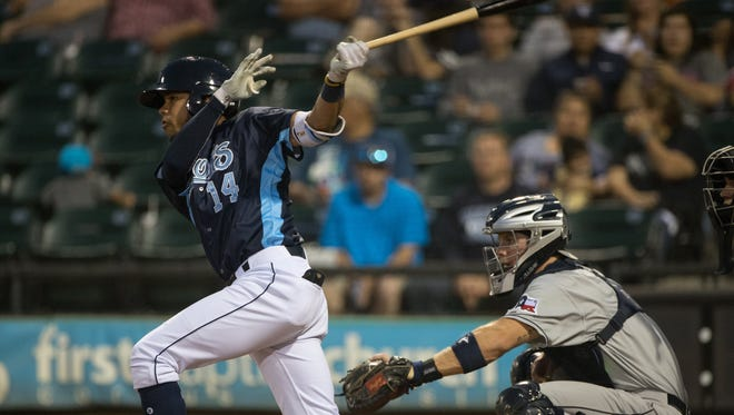 Hooks Kristian Trompiz hits a single during the fourth inning of their game against San Antonio Mission at Whataburger Field on Tuesday, May 9, 2017.