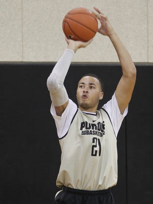 Kendall Stephens takes a three-point shot during a men's basketball practice. Kendall Stephens with a 3-point shot during men's basketball practice Monday, October 5, 2015, at Cardinal Court on the campus of Purdue University.