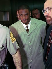 FILE - In this March 11, 1997 file photo, St. Louis Rams' Lawrence Phillips leaves Lancaster County Court in Lincoln, Neb., to begin a 30-day sentence for a probation violation. Phillips, 34, was sentenced Friday, Dec. 18, 2009, in San Diego for assault and other crimes.  Phillips has been sentenced to more than 31 years in prison for attacking his girlfriend and driving his car into three teens. Phillips told the judge he didn't get a fair trail and he'll appeal. (AP Photo/Dennis Grundman, File)
