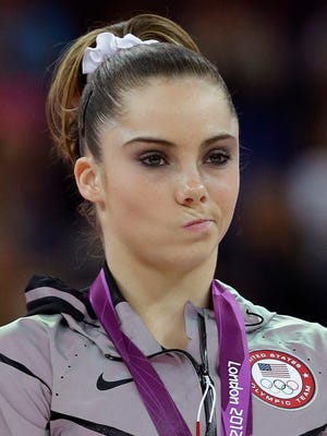 In a file photo from August 2012, U.S. silver medallist gymnast McKayla Maroney gestures during the podium ceremony.