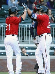 Huner Renfroe, right of the El Paso Chihuahuas, celebrates