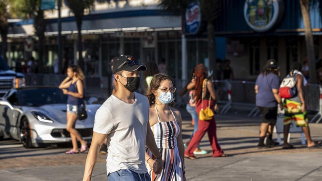 Though barricades were in place, the Saturday of Memorial Day weekend looked much different from years past. Tourists, some wearing masks, walked Ocean Boulevard and played in the sand in Myrtle Beach. S.C., on May 23.