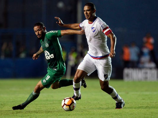 Arthur of Brazil's Chapecoense, left, fights for the ball with Diego Arismendi of Uruguay's Nacional during a Copa Libertadores soccer match in Montevideo, Uruguay, Wednesday, Feb. 7, 2018. (AP Photo/Matilde Campodonico)