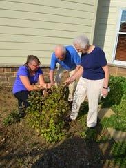Becky Williams, Karl Yochum and Doris Yochum inspect