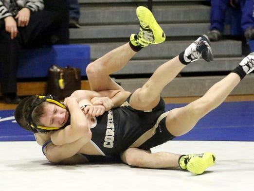 Action from the Horseheads wrestling team's 52-24 victory