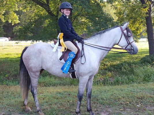 636416047499038503-EquestrianWinner.jpg