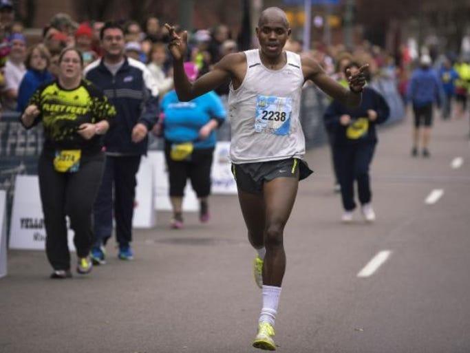 "Kiplangat ""Kip"" Tisia of Rochester after winning the Flower City Half Marathon earlier this year."