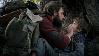 "John Krasinski, left, and Noah Jupe play a father and son who must stay silent to survive in box-office phenomenon ""A Quiet Place."""