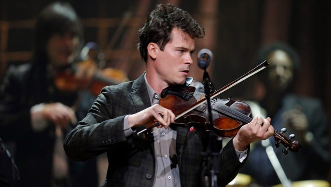 "Ketch Secor of The Old Crow Medicine Show performs during the Americana Music Honors and Awards Show in Nashville, Tenn., on Sept. 18, 2013. The band had their biggest hit of its career by adapting an unfinished Bob Dylan song into ""Wagon Wheel,"" which became a staple in both Americana and country music."
