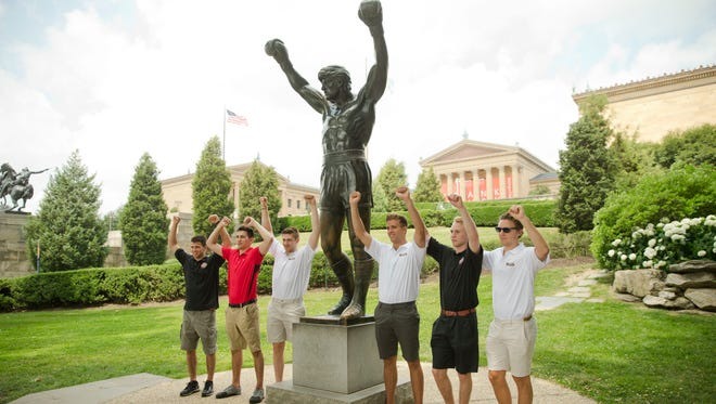NHL prospects, from left,Anthony DeAngelo, Michael Dal Colle, Leon Draisaitl, Aaron Ekblad, Samuel Bennett, and Sam Reinhart pose for photographs with the Rocky Balboa statue at the Philadelphia Museum of Art.
