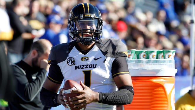 Missouri quarterback James Franklin (1) smiles on the sidelines during the Tigers' Nov. 9 game against Kentucky at Commonwealth Stadium. Missouri defeated the Wildcats 47-17.
