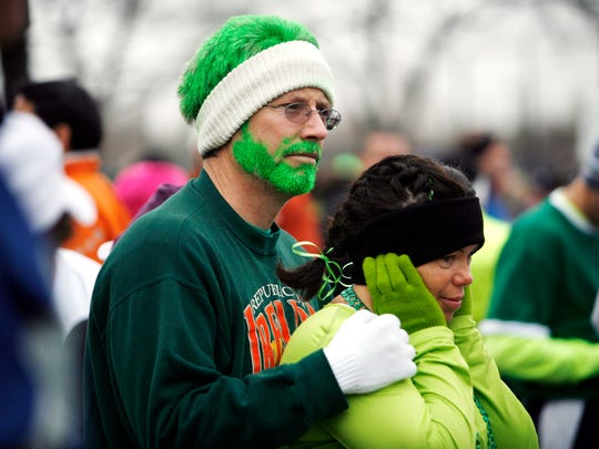 John Cusack and Lisa Forester try to stay warm minutes before the beginning of the 2007's Shamrock Run and Walk.