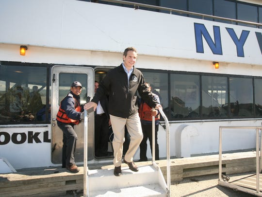 Governor Andrew Cuomo departs the NY Waterway boat after a tour of the new bridge site with the I Lift NY super crane.  The crane arrived near the Tappan Zee Bridge, Oct. 6, 2014.  It is going to help in the construction of the New New York Bridge.