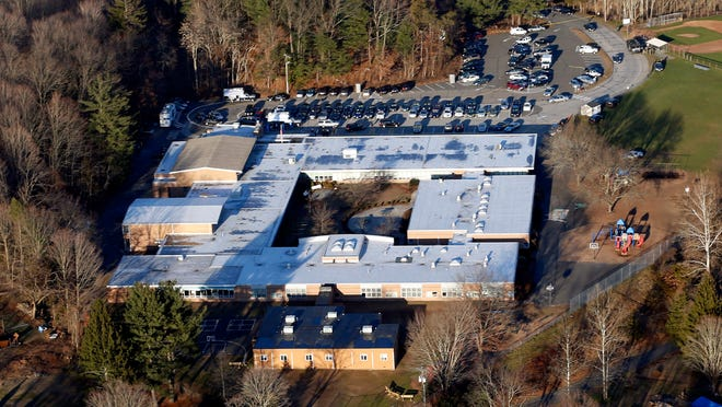 An aerial file photo from Dec. 14, 2012, shows Sandy Hook Elementary School in Newtown, Conn., where a gunman shot and killed 26 people, including 20 children.