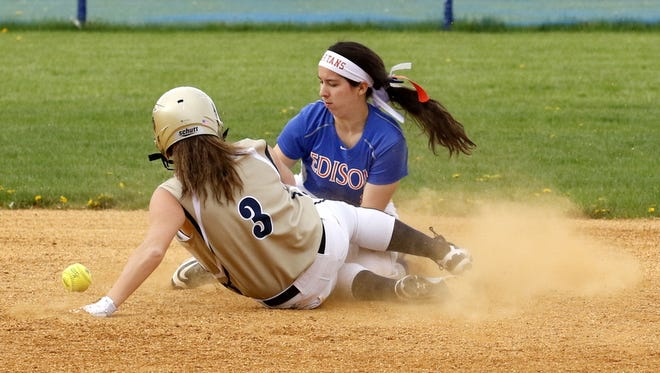 Elmira Notre Dame's Izzy Milazzo safely slides into second base as Thomas A. Edison shortstop Mackenzie Bonyak is unable to handle the throw Friday during the Crusaders' 11-3 win in Elmira Heights.