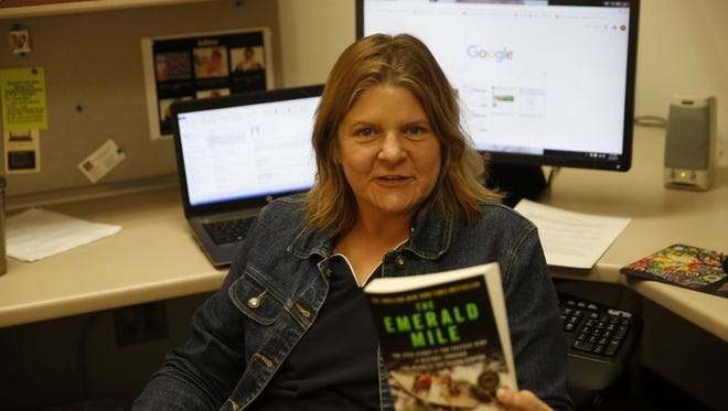 """Assistant Professor of English Danielle Sullivan says author Kevin Fedarko's """"The Emerald Mile"""" likely will appeal to many local readers, which is partly why it was chosen as this year's selection for San Juan College's One Book/One Community program."""
