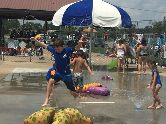 Jacob Jolley of Clarksville cools off and celebrates