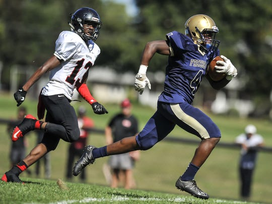 Freehold freshman running back Ahmad Dixon breaks free