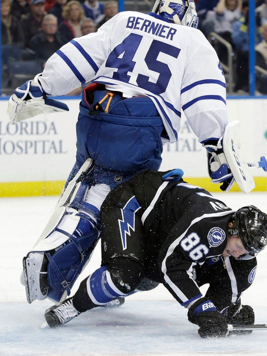 Tampa Bay Lightning right wing Nikita Kucherov (86), of Russia, crashes into Toronto Maple Leafs goalie Jonathan Bernier (45) during the second period of an NHL hockey game Wednesday, Jan. 27, 2016, in Tampa, Fla. Kucherov was penalized for embellishment. (AP Photo/Chris O'Meara)