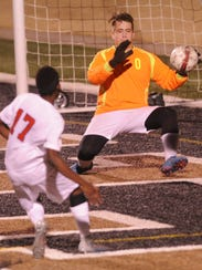 Brownwood goalie Caleb Woodcock, right, makes a stop
