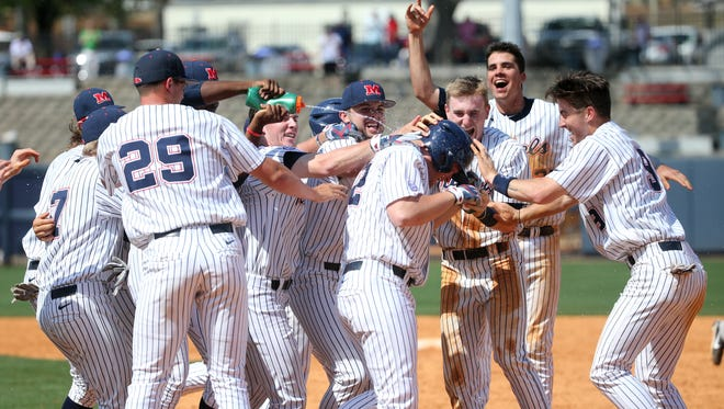 Michael Fitzsimmons was was mobbed by his teammates after his game-winning single in the 10th inning.
