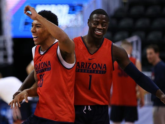 Arizona's Allonzo Trier, left, has reportedly reached